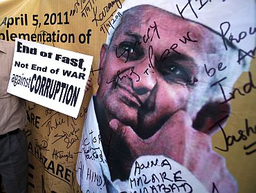 A supporter of social activist Anna Hazare holds a placard during a campaign against corruption, in