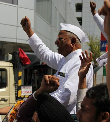 Social activist Anna Hazare on his way to Jantar Mantar to begin his fast unto death against corruption