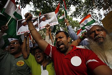 Supporters of Anna Hazare shout slogans during a protest rally against corruption in Mumbai