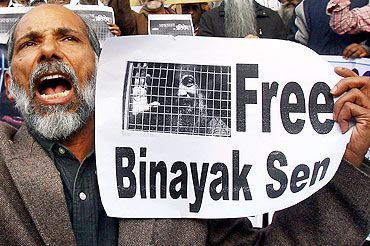 A demonstrator holds a placard as he shouts slogans during a protest demanding for the release of Dr Binayak Sen, in Chandigarh