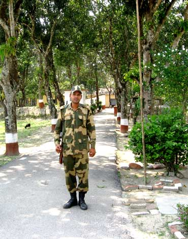 A Border Security Force jawan guards the Indo-Bangladesh border at Khalpara in Haldibari
