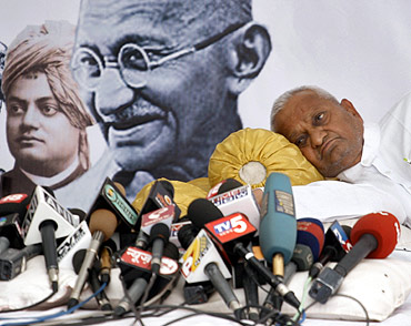 Social activist Anna Hazare rests during a 'fast unto death' campaign in New Delhi April 8, 2011