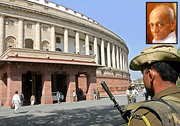 A policeman keeps vigil outside Parliament in New Delhi, inset, H Y Sharada Prasad