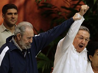 Former Cuban leader Fidel Castro with his brother, Cuba's President Raul Castro, during the closing ceremony of the sixth Cuban Communist Party congress in Havana