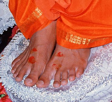 Sathya Sai Baba's devotees pray for a miracle