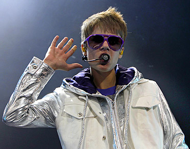 Canadian pop singer Justin Bieber performs on stage during his concert in Singapore