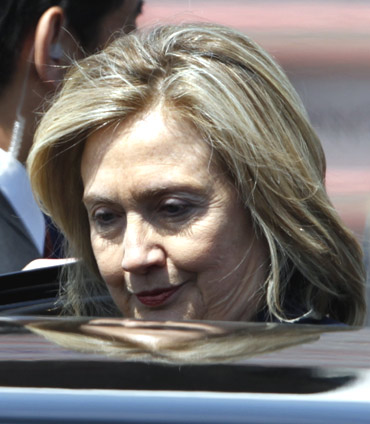 US Secretary of State Hillary Clinton gets on a car after arriving at Haneda airport in Tokyo