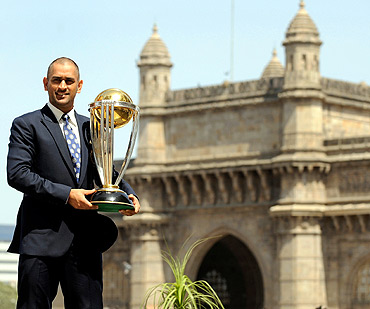 India's captain Mahendra Singh Dhoni lifts the trophy at the Taj hotel