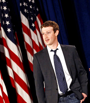 Facebook CEO Mark Zuckerberg arrives for the start of a town hall meeting with U.S. President Barack