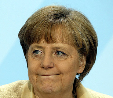 German Chancellor Angela Merkel addresses a news conference after a prime minister meeting in Berlin