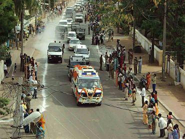 Mortal remains of Sai Baba being taken to the Sai Kulwant Hall in Puttaparthi on Sunday.