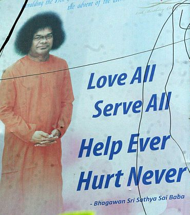 A poster depicting Sai Baba's message on display in Hyderabad