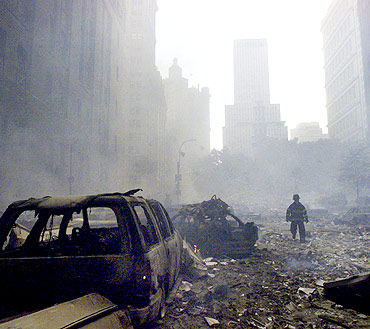 A firefighter walks amid rubble near the base of the destroyed World Trade Centre on Sept 11, 2001