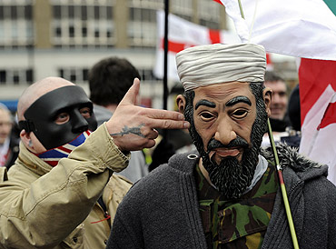 A man wears an Osama bin Laden mask during a rally