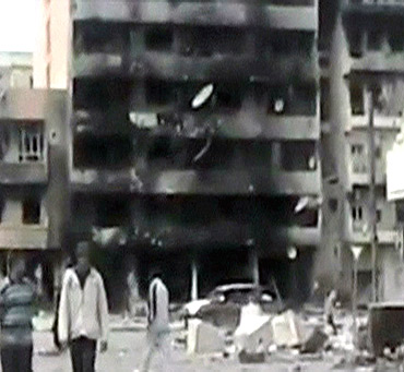 A damaged building is seen in an area purported to be in Misrata in this still image from a video