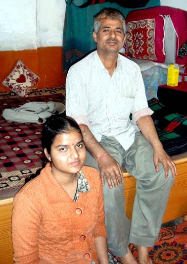 Bharatbhushan Dhar with his daughter, Priyanka