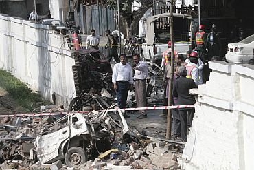 Officials survey the site where a suicide bomber killed at least six people and wounded 19 in an attack on a Pakistan naval college in Lahore in May, 2008.