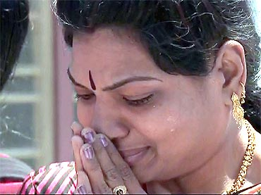 A devotee weeps as Sai Baba's last rites were performed in Puttaparthy on Wednesday