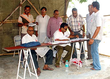 Officials at a polling booth in Kolkata