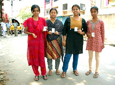 First-time voters proudly flaunt their voter idendity cards