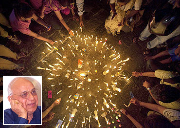 Demonstrators light candles in front of the Gateway of India during a campaign against corruption in Mumbai and (inset) Subhash C Kashyap
