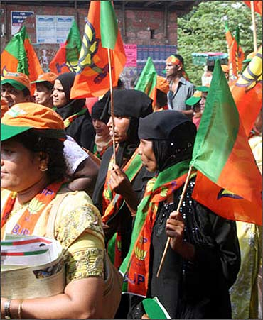 Women participate in a political rally