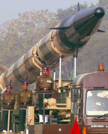 Soldiers stand alongside the Agni-2 missile