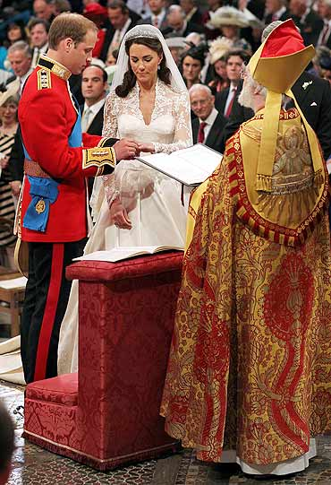 Prince William, and Kate Middleton exchange rings before the Archbishop of Canterbury, Rowan Williams, during their wedding ceremony in Westminster Abbey on Friday