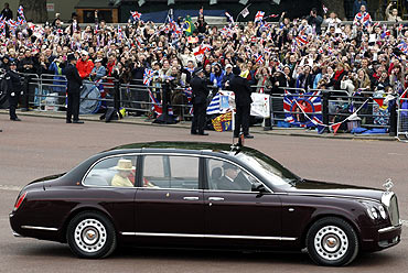 Britain's Queen Elizabeth and Prince Philip leave Buckingham Palace to travel to Westminster Abbey for the wedding