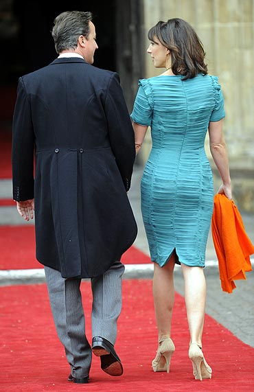 Britain's Prime Minister David Cameron (L) arrives with his wife Samantha at Westminster Abbey before the wedding of Britain's Prince William and Kate Middleton