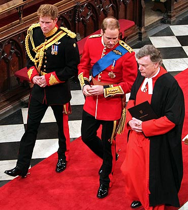 Prince William, and his brother and best man Prince Harry (L) and Stephen Lamport, Receiver General of the Abbey (R), arrive at Westminster Abbey