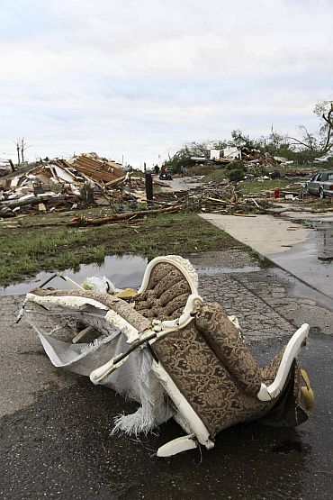 The aftermath of overnight tornadoes leaves ruined neighbourhoods in Pratt City, a suburb of Birmingham, Alabama
