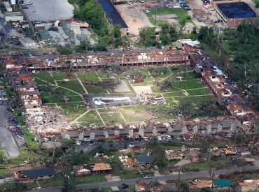 An aerial view shows extensive damage to homes and businesses in the path of tornadoes in Tuscaloosa