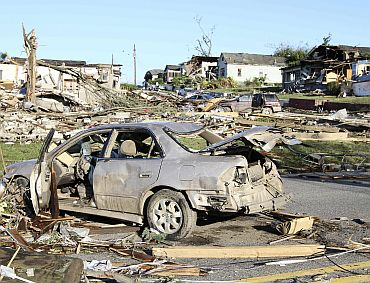 The aftermath of overnight tornadoes show destroyed homes and vehicles in Pratt City, a suburb of Birmingham, Alabama