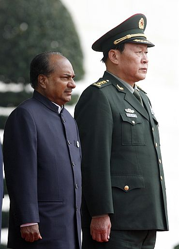 China's Defence Minister Liang Guanglie (R) stands next to India's Defence Minister A K Antony