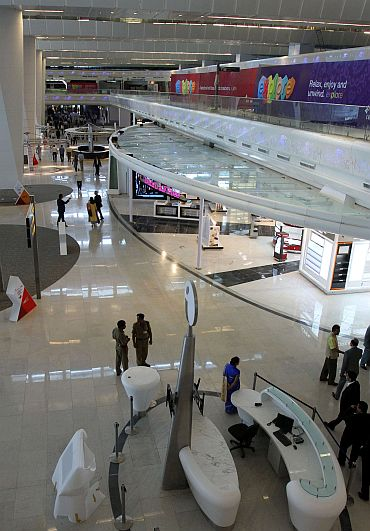 People walk inside the newly constructed Terminal 3 at Indira Gandhi International Airport in New Delhi