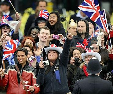 People gather outside Buckingham Palace before the wedding