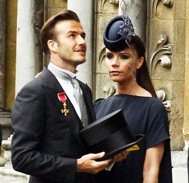 Soccer star David Beckham and his wife Victoria arrive at Westminster Abbey before the wedding