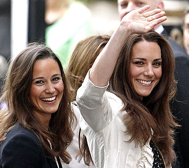 Kate Middleton, the fiancee of Britain's Prince William, waves as she arrives with her sister Pippa