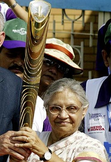 Delhi CM Sheila Dikshit with the Queen's Baton