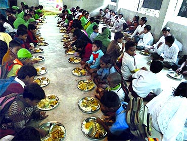 Students at Basu's school share a meal