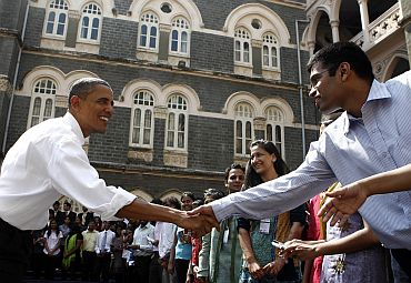 President Obama greets students after a town hall meeting at St Xavier's College in Mumbai