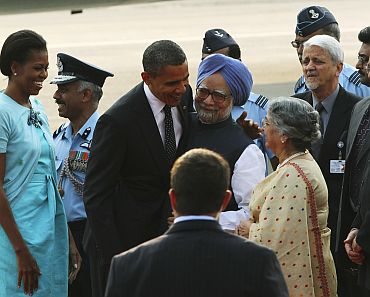 President Obama and the first lady are greeted by PM Singh and his wife upon their arrival at New Delhi's airport