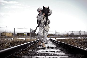 Handout image shows a US Navy SEAL commander with his military dog
