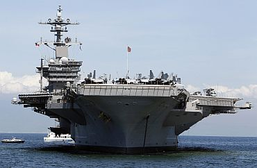 US navy's USS Carl Vinson aircraft carrier, where Osama bin Laden was given burial ritual, is seen anchored off the Manila bay.