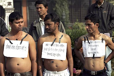 Members of the Dalit community participate in a protest rally
