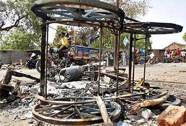 A file photo of burnt vehicles at the site of a clash between Dalits and upper caste Hindus