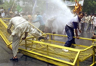 Police use water cannons to disperse protestors during a protest rally by Dalits