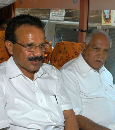 Ousted Karnataka chief minister with newly elected CM Sadananda Gowda
