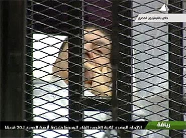 Former Egyptian president Hosni Mubarak in the courtroom for his trial at the police academy in Cairo
